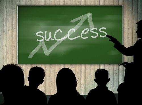 Success written on a blackboard