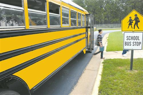 School bus drops off student at bus stop