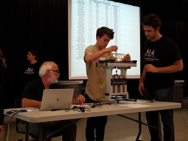 students test their bridges at the international competition