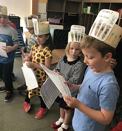students take turns narrating a storybook