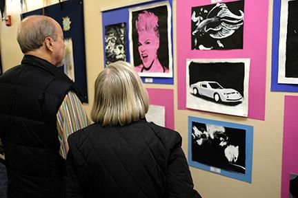 guests look at artwork on the walls during District Arts Night