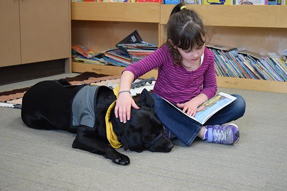 Student reads to a dog
