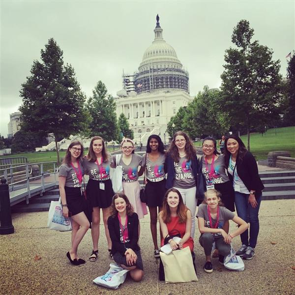 Girl Up club members standing in front of the Capitol building.