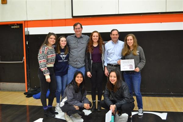 Members of the girls' basketball team receive a league sportsmanship award