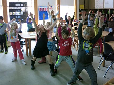 1st and 2nd graders practice Yoga in class