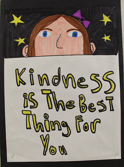 Drawing of girl with sign saying kindness is the best thing for you