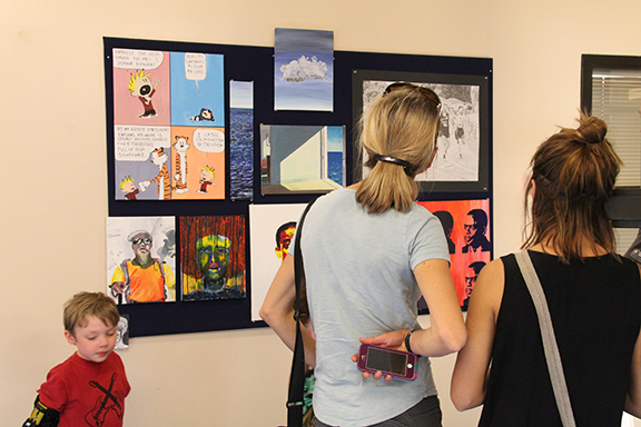 guests looking at artwork on the wall