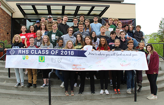 class of 2018 holding up banner with college choices