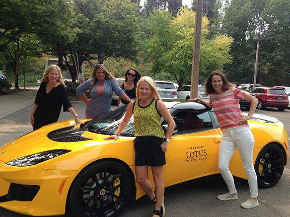 Riverdale parents attend the silent auction and pose with a car