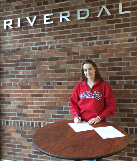 Marissa signs letter of intent paperwork