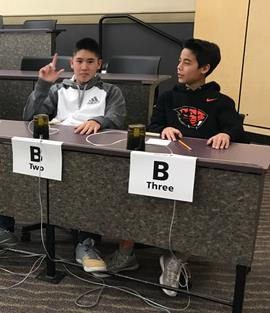 Two male students participate in Science Bowl competition