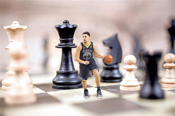 Klay Thompson playing basketball on a chess board