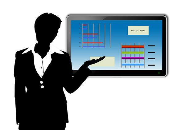 silhouette of woman with presentation screen on the wall