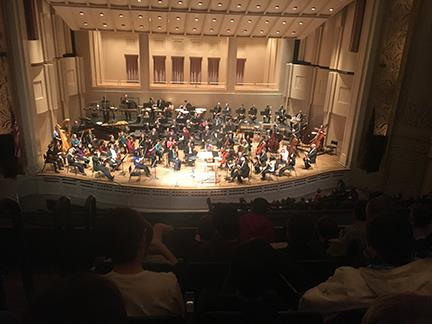 Oregon Symphony performs onstage