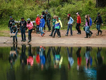 6th graders walk to the lake during Outdoor School