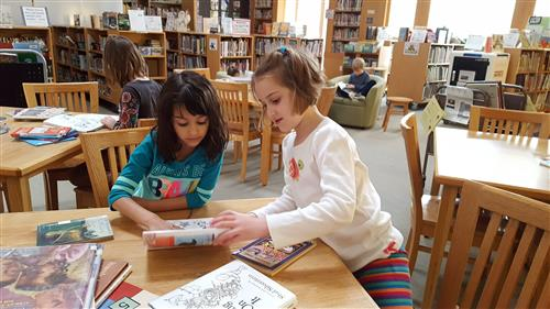 young girls in library