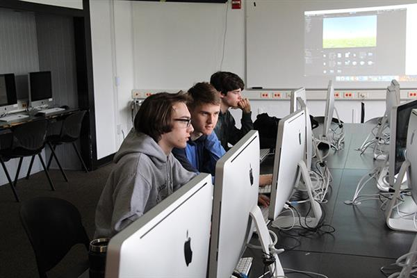 high school students using computer lab